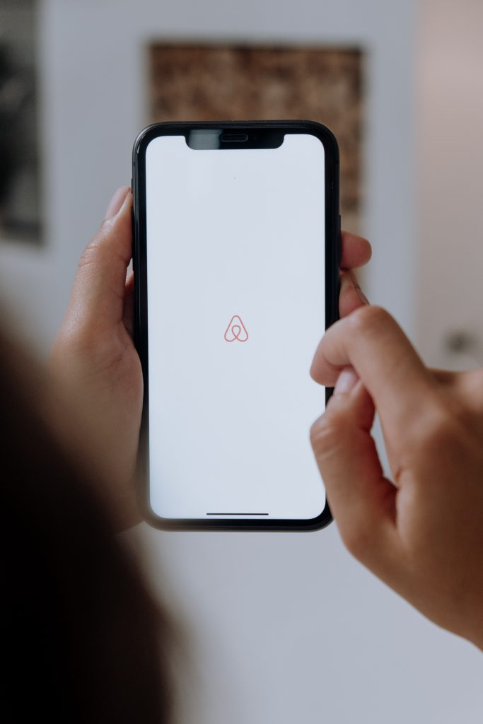 Airbnb logo on a mobile phone
