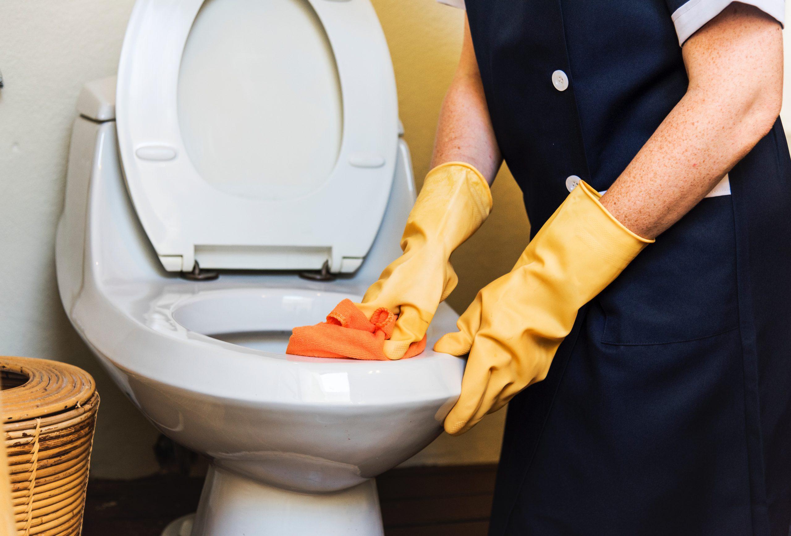 a host cleaning their bathroom